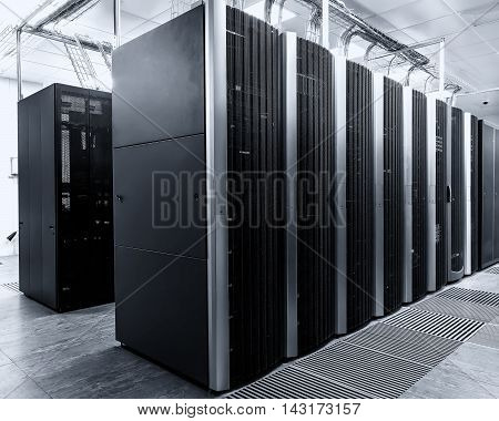 room with rows of modern supercomputers in the data center