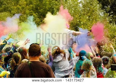 Holi festival. Children throw colored powder in the animator.