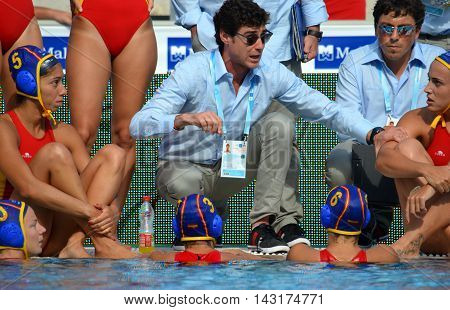 Budapest, Hungary - Jul 16, 2014. Spain's OCA Miguel head coach talking about the tactics. The Waterpolo European Championship was held in Alfred Hajos Swimming Centre in 2014.