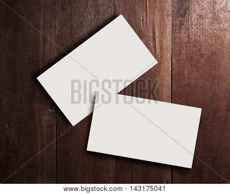 Business card blank on wooden texture in still life and dark tone