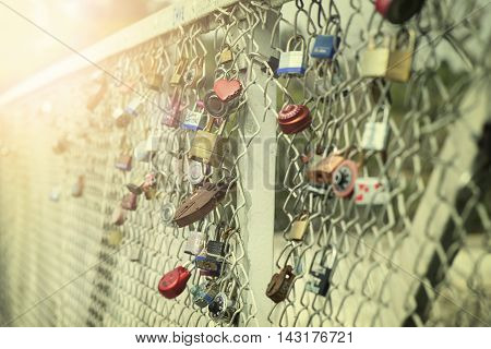 Padlocks locked on iron chain. Vintage effect