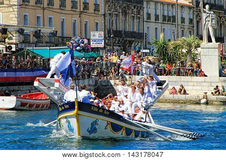 SETE, FRANCE - August 23, 2014: Water Jousting performance during St.Louis festival at the streets of Sete South of France on August 23 2014. Saint Louis is the patronal feast of Sete and also the jousters holiday