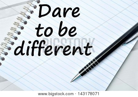 Dare to be different on white ring binder on notebook