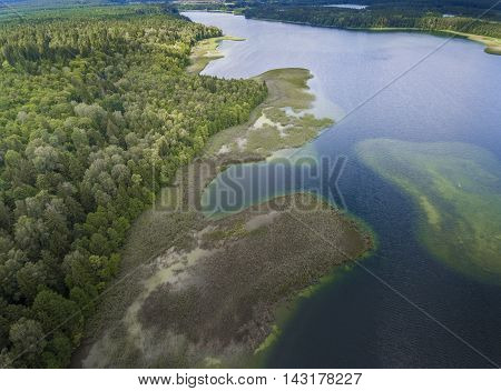 View Of Small Islands On The Lake In Masuria And Podlasie District, Poland.blue Water And Whites Clo