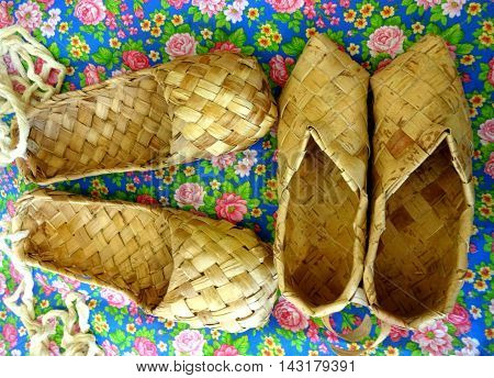 Ancient Russian footwear on a floral background