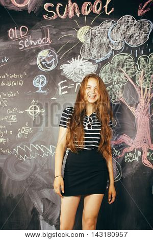 back to school after summer vacations, cute teen real girl in classroom, lifestyle people concept