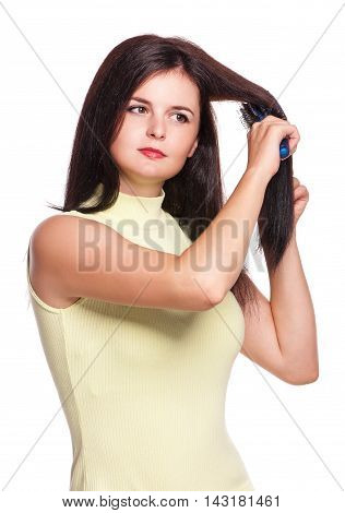 Young pretty woman comb her hairs isolated on white background