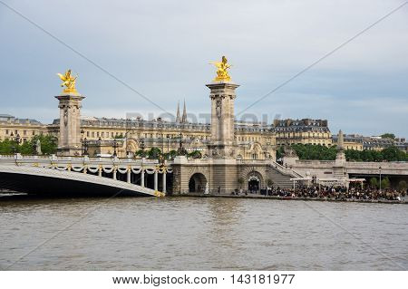 PARIS FRANCE - MAY 07 2015: Pont Alexandre III bridge over the river Seine in the dusk Paris France