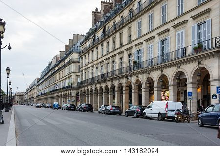 PARIS FRANCE - MAY 07 2015: Buildings of Rue de Rivoli in the historical center of Paris in the dusk France
