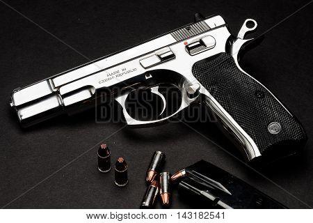 Las Vegas NV USA - January 25 2016: Closeup of CZ75 semiautomatic handgun with 9mm ammunition and magazine.