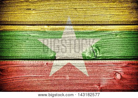flag of Myanmar painted on old grungy wooden background: 3d illustration