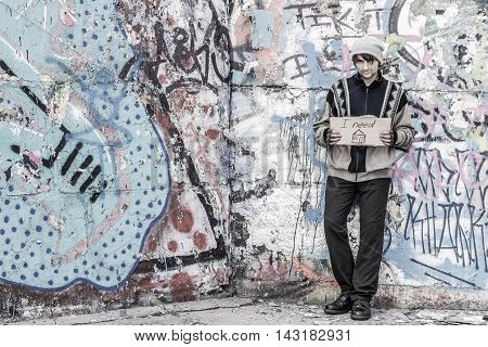 Homeless Man Near Wall