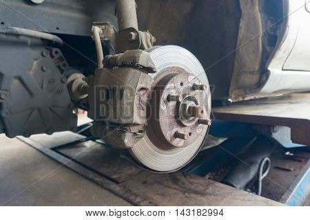 Rusty Front Car Wheel Hub With Disk Brake System