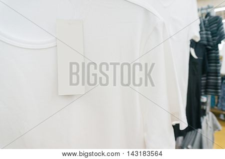 Blank Price Tag Hang Over White Tshirt On Hanger Shelf In Supermarket