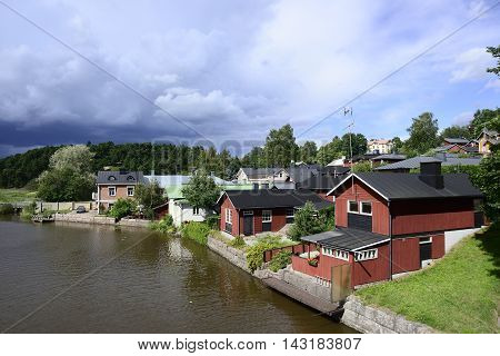 wooden houses by the river in old part of Porvoo