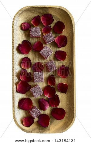 cranberry marmalade and rose petals on wooden tray