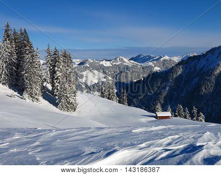 Winter landscape in Gstaad Switzerland. View from Mt Wispile.