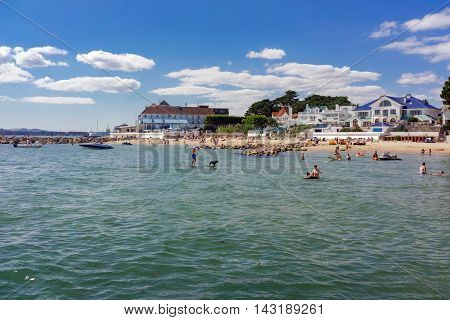Sandbanks/UK. 14th July 2016. Warm weather attracts beach goers and holiday makers to the clear blue waters and sandy beaches of Sandbanks in Dorset.