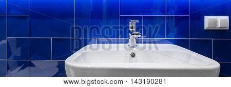 Bathroom With Shiny Blue Tiles