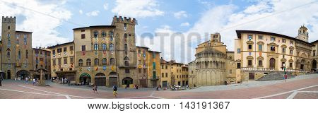 Arezzo Italy - August 1 2016: The Piazza Grande square located in the old town of Arezzo Tuscany Italy.
