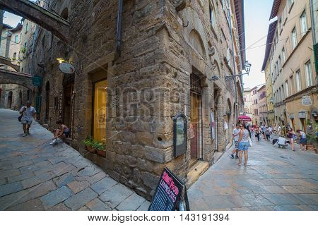 Volterra Italy - August 3 2016: Wide angle view of the streets of the medieval city of Volterra Tuscany Italy.