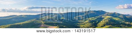 Wide panoramic landscape of surroundings of the village of Radda in Chianti Tuscany Italy.