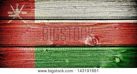 flag of Oman painted on old grungy wooden background: 3d illustration