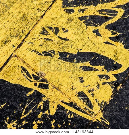 Abstract Background Tecture Of Yellow Paint Spilled On Black Tarmac