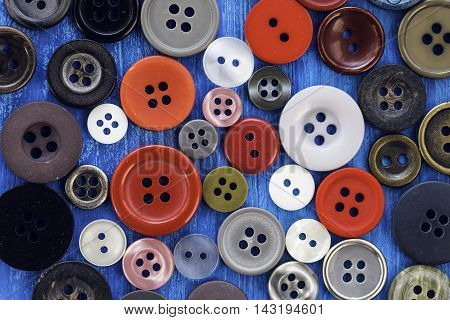 Lots of colorful sewing buttons, vintage background