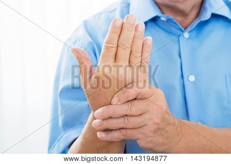 Close-up Photo Of A Person Holding Wrist