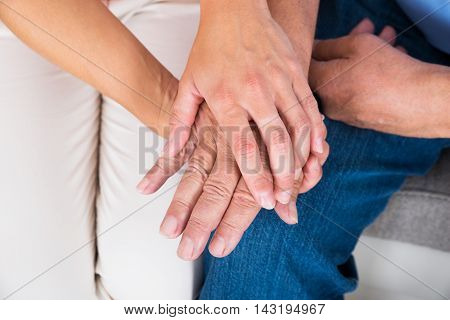 Close-up Of A Daughter Holding Her Father's Hand
