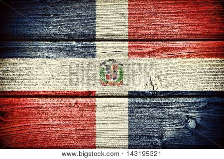 flag of the Dominican Republic painted on old grungy wooden background: 3d illustration