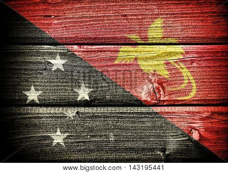 flag of Papua New Guinea painted on old grungy wooden background: 3d illustration