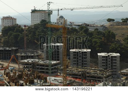 triple construction building construction, under a blue sky