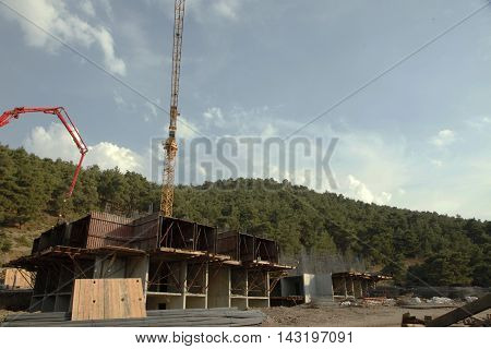 building pouring concrete, rebar under the sky