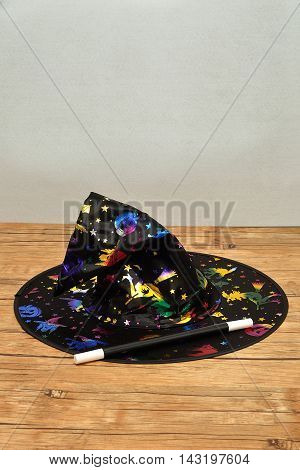 A colorful witches hat with a magic wand