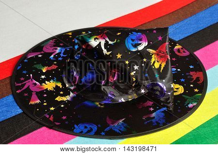 A witches hat on a colorful background