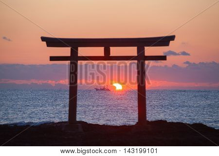 Sunrise and sea at Japanese shinto gate in Oarai city Ibaraki prefecture