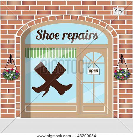 Shoe repairs.Red brick building facade. Vector illustration.