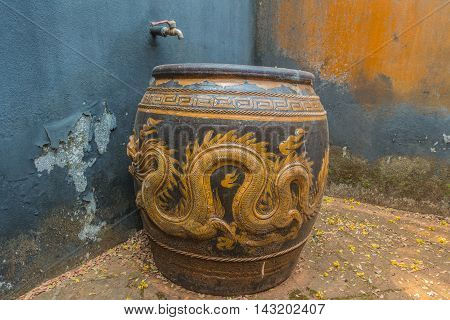glazed water jar with dragon pattern thai