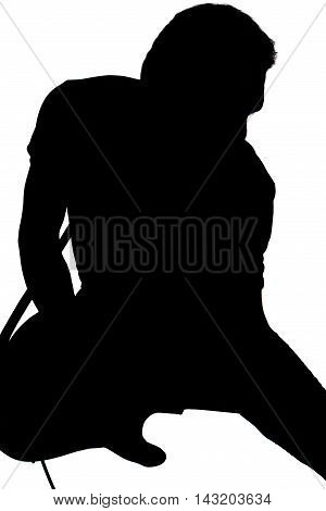 Silhouette of Male Expressive Guitar Player. Vertical Image