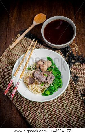 Asian Noodle Soup With Beef Meatball With Fresh Vegetable On Wood Table