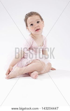 Portrait of Little Cute Caucasian Girl Posing Against White Background. Vertical Image