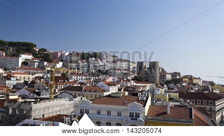 LISBON, PORTUGAL - September 28, 2015: Cityscape from the lookout on top of the Augusta Street Arch towards the Alfama district in Lisbon Portugal. Features the old Cathedral. on September 28, 2015 in Lisbon, Portugal