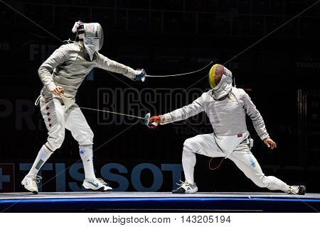 Moscow Russia - May 30 2015: Unidentified professional fencers in the finals of the men's individual event at the 2015 Moscow Sabre international fencing tournament.