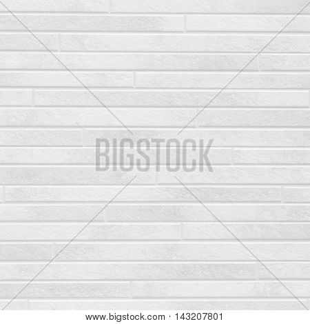 The modern white concrete tile wall background and texture .