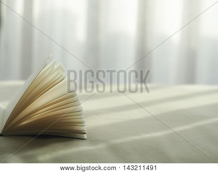 Fresh morning read book on the bed, select focus.