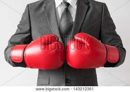 Businessman In Boxing Gloves Isolated On White Background (selective Color On Red)