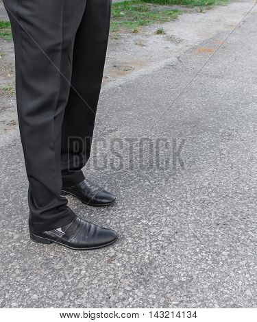 men pants and shoes. Legs of businessmen. black trousers and shoes.  on the floor