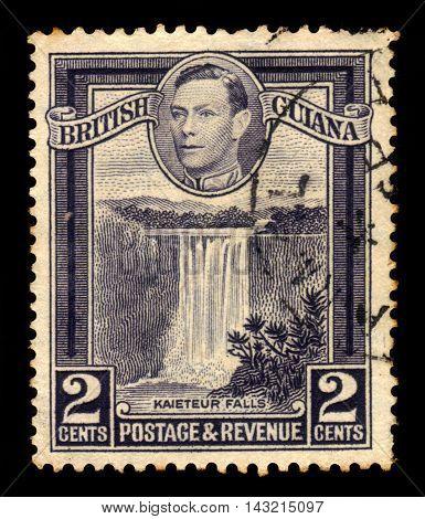 BRITISH GUIANA - CIRCA 1938: a stamp printed in British Guiana shows Kaieteur Falls, waterfall on the Potaro River, Guyana and King George VI, circa 1938